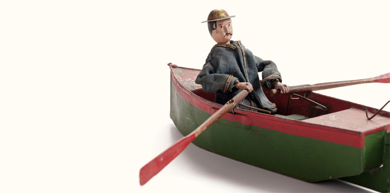 mechanical toy oarsman