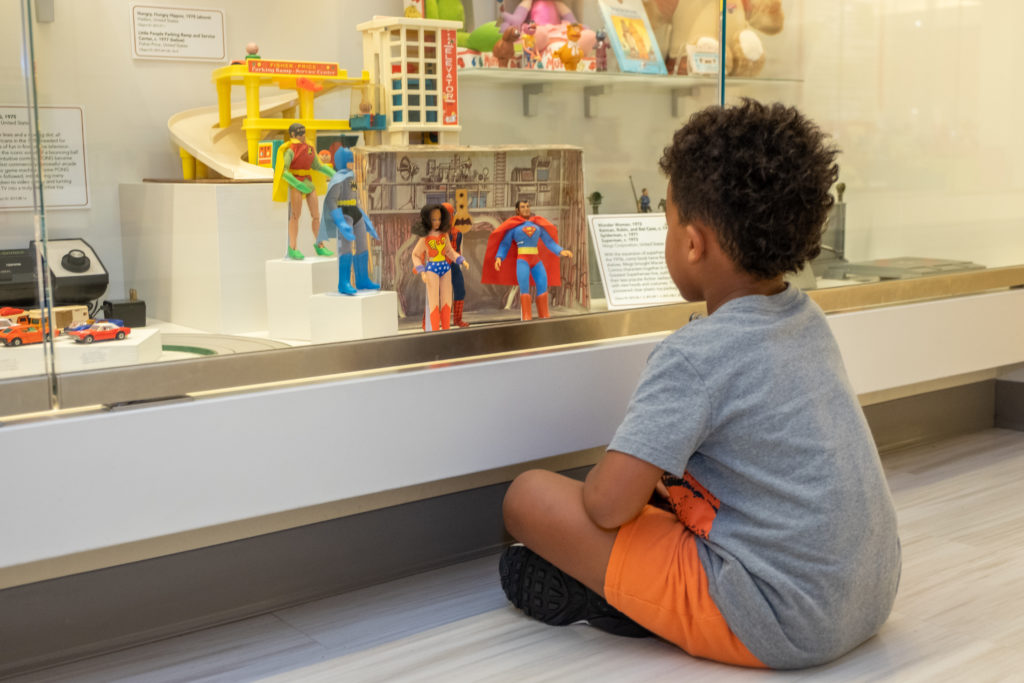 little boy looking at toys